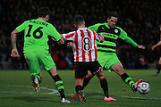 Aarran Racine, Billy Waters and Darren Carter during the Vanarama National League match between Cheltenham Town and Forest Green Rovers at Whaddon Road, Cheltenham, England on 21 November 2015. Photo by Antony Thompson.