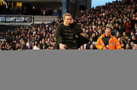 Photo: Ed Godden.<br /> Fulham v Chelsea. The Barclays Premiership. 19/03/2006.<br /> A Fulham fan taunts the Chelsea fans at full time.