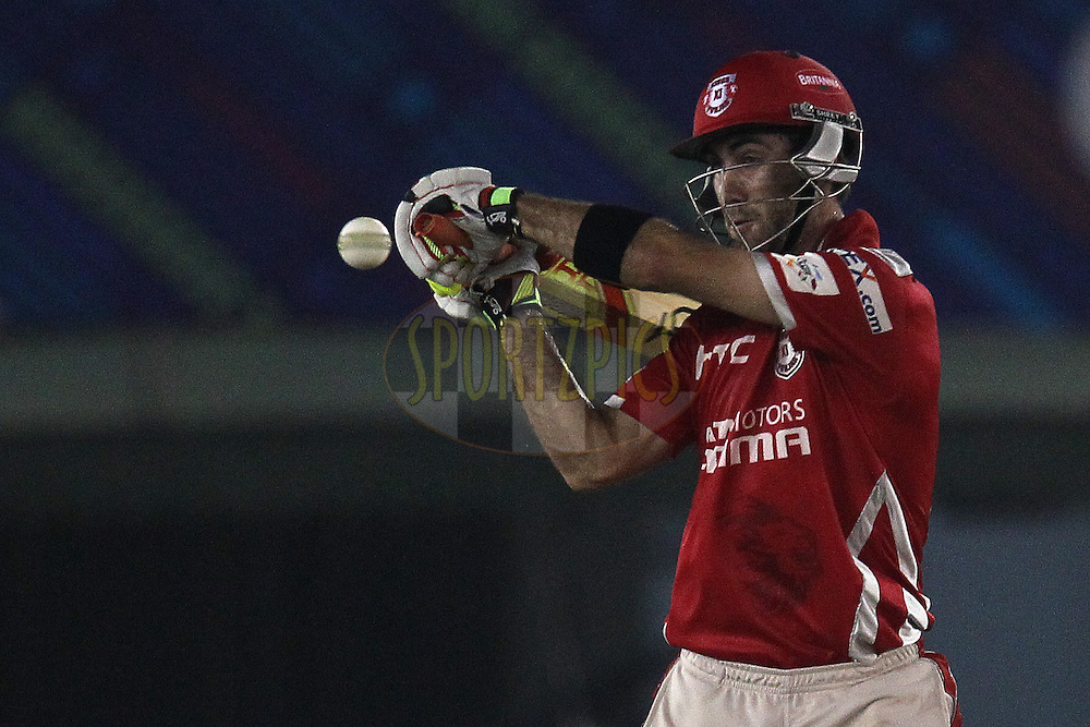 Glenn MAXWELL of the Kings XI Punjab reaches out but misses the delivery during match 2 of the Oppo Champions League Twenty20 between the Kings XI Punjab and the Hobart Hurricanes held at the Punjab Cricket Association Stadium, Mohali, India on the 18th September 2014<br /> <br /> Photo by:  Ron Gaunt / Sportzpics/ CLT20<br /> <br /> <br /> Image use is subject to the terms and conditions as laid out by the BCCI/ CLT20.  The terms and conditions can be downloaded here:<br /> <br /> http://sportzpics.photoshelter.com/gallery/CLT20-Image-Terms-and-Conditions-2014/G0000IfNJn535VPU/C0000QhhKadWcjYs