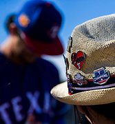 A fan wears Texas Rangers pins on her hat as Texas Rangers starting pitcher Yu Darvish (11) signs autographs during a spring training workout at the team's training facility on Thursday, February 16, 2017 in Surprise, Arizona. (Ashley Landis/The Dallas Morning News)