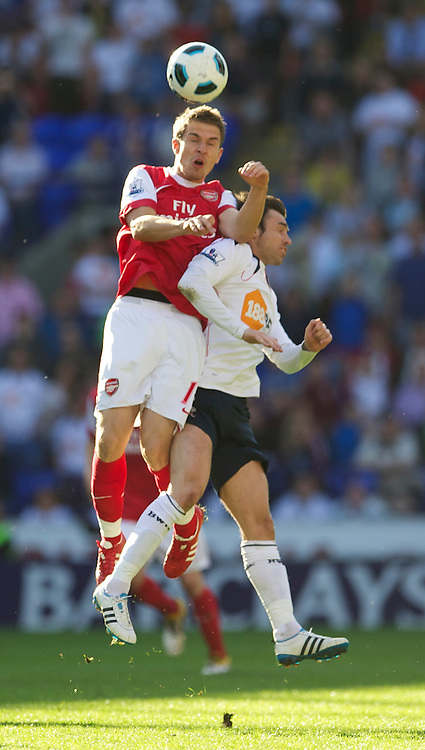 BOLTON, ENGLAND - Easter Sunday, April 24, 2011: Arsenal's Aaron Ramsey and Bolton Wanderers' Tamir Cohen during the Premiership match at the Reebok Stadium. (Photo by David Rawcliffe/Propaganda)