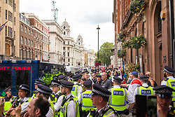 © Licensed to London News Pictures. 31/08/2019. London, UK. Police surround a group of right-wing pro-Brexit activists as thousands of protesters gather outside Downing Street to protest against the suspension of Parliament. The Queen has approved Prime Minister Boris Johnson's request to prorogue Parliament shortly after MPs return to work in September, a few weeks before the Brexit deadline of 31 October. Photo credit: Rob Pinney/LNP