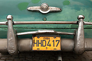 The back bumper of a vintage Buick Eight Special in Old Havana. The great number of American-made vintage cars in Cuba remain a vestige of the country's pre-embargo era. Kept running despite a lack of parts, they also are a symbol of Cuban resolve.