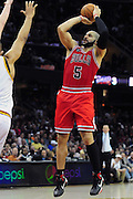 April 8, 2011; Cleveland, OH, USA; Chicago Bulls power forward Carlos Boozer (5) shoots a jump shot over Cleveland Cavaliers center Ryan Hollins (5) during the fourth quarter at Quicken Loans Arena. The Bulls beat the Cavaliers 93-82. Mandatory Credit: Jason Miller-US PRESSWIRE