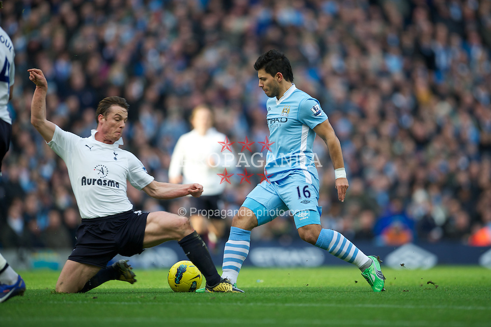 MANCHESTER, ENGLAND - Sunday, January 22, 2011: Manchester City's Sergio Aguero in action against Tottenham Hotspur's Scott Parker during the Premiership match at the City of Manchester Stadium. (Pic by David Rawcliffe/Propaganda)