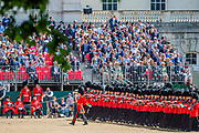 The Guards regiments march past Chelsea pensioners in slow and quick time - The parade on Horse Guards - His Royal Highness the Duke of York reviews the final rehearsal for the Trooping the Colour on Horseguards Parade and the Mall.
