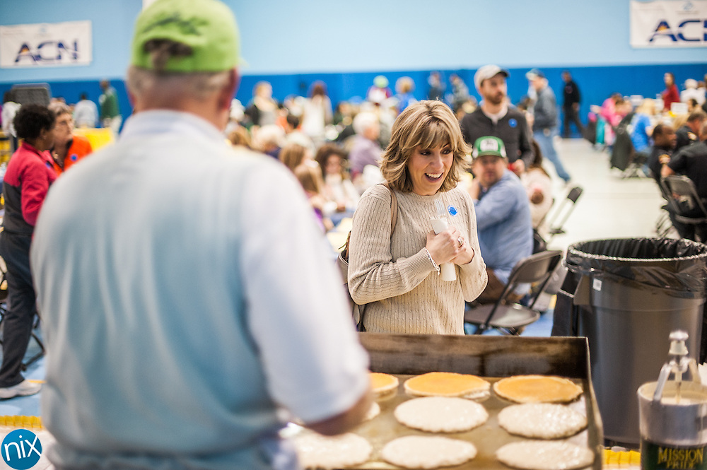 Amy Gray gets ready to pick up hot pancakes during the 58th annual Pancake Day at the Boys & Girls Club of Cabarrus County Thursday morning.