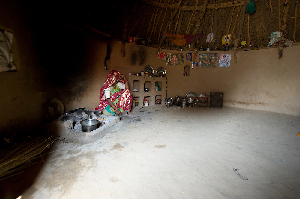 Cooking food or chai (spiced India tea) in a traditional kitchen of a low-income family. Often firewood or cowdung are used as fuel.