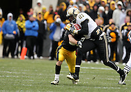 15 NOVEMBER 2008: Purdue wide receiver Greg Orton (21) tries to get away from Iowa defensive back Brett Greenwood (30) in the second half of an NCAA college football game against Purdue, at Kinnick Stadium in Iowa City, Iowa on Saturday Nov. 15, 2008. Iowa beat Purdue 22-17.
