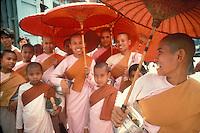 Women monks  on their way to receive offerings of food, in Rangoon (Yangon), Myanmar (Burma)<br /> Photo by Owen Franken