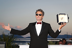71st Cannes Film Festival Prizes Photocall. Polish director Pawel Pawlikowski poses with the trophy on May 19, 2018 during a photocall after he won the Best Director prize for the film Zimna Wojna (Cold War) at the 71st edition of the Cannes Film Festival. Photo by Shootpix/ABACAPRESS.COM