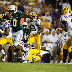 Sep 8, 2018; Baton Rouge, LA, USA; Southeastern Louisiana Lions quarterback Lorenzo Nunez (10) breaks away from LSU Tigers linebacker Micah Baskerville (23) during the second half of a game at Tiger Stadium. LSU defeated Southeastern 31-0. Mandatory Credit: Derick E. Hingle-USA TODAY Sports
