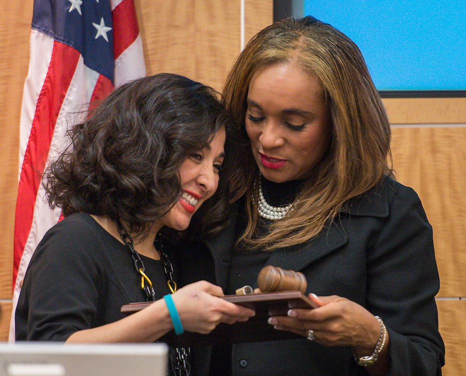 New president Rhonda Skillern-Jones, right, presents outgoing president Juliet Stipeche, left, with an award during a Houston ISD Board of Trustees meeting, January 15, 2015.