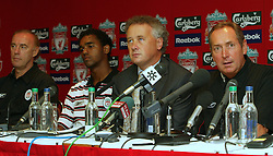 LIVERPOOL, ENGLAND - Thursday, July 10, 2003: Liverpool manager Gerard Houllier, Cheif-Executive Rick Parry (c) with new signing Florent-Sinama Pongolle (l) and coach Christian Damiano (far left) at a press conference at Anfield. (Pic by David Rawcliffe/Propaganda)