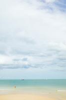 Mature man wading  on Ao Thong Nai Pan Noi Gulf of Thailand Ko (Koh) Phangnan (Phangan) Thailand&#xA;<br />