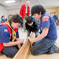 020213       Cable Hoover<br /> <br /> Cub Scouts Cody Koons, left, and Richard Quam assemble the race track while Quam's little brother Hunter Quam watches during the pinewood derby in Zuni Saturday.