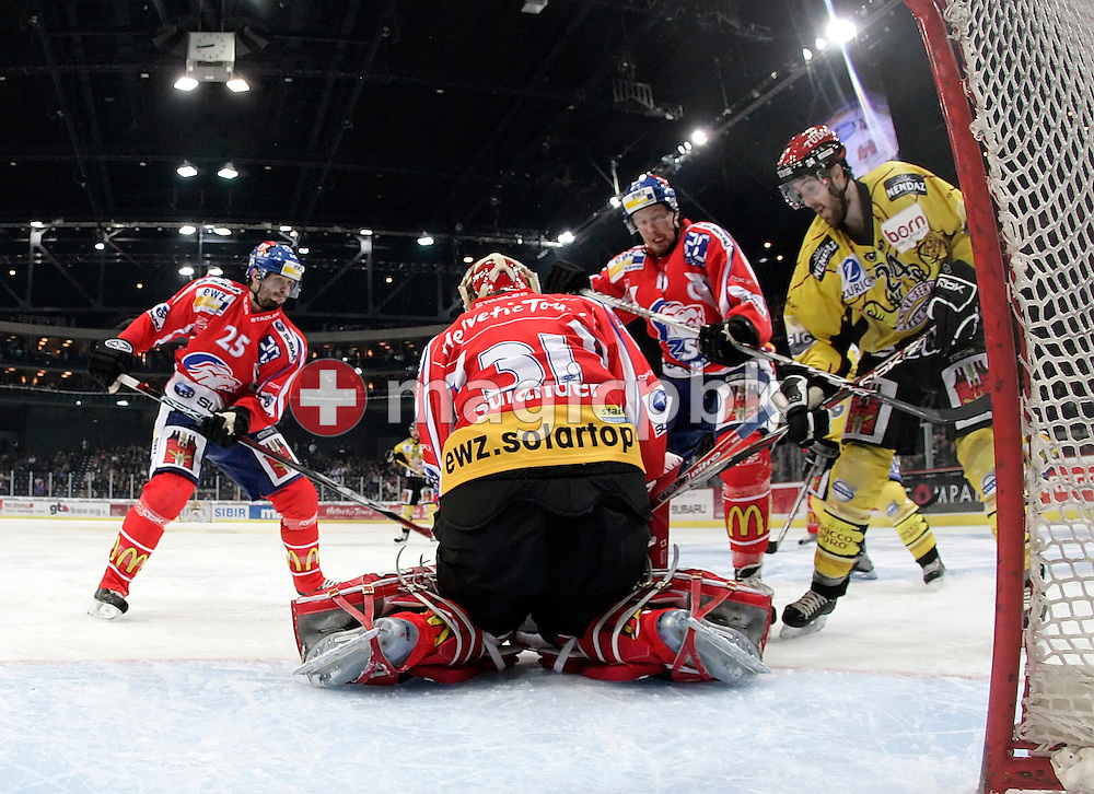 Goaltender Ari Sulander (C) of the ZSC Lions makes a save against Geneva's Jean-Pierre Vigier (R) while Zurich's Radoslav Suchy (L) and Mathias Seger (2nd R) defend during the Swiss NHL Play-Off final ice hockey game between ZSC Lions and Geneve-Servette HC held at the Hallenstadion in Zuerich, Switzerland, Monday, March 31, 2008. Geneve-Servette HC wins 4:2 and leads the best of 7 series 2:0. (Photo by Patrick B. Kraemer / MAGICPBK)
