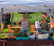 Belmar, NJ USA -- June 24, 2017 Two women working a produce stand at a Farmers Market. Editorial Use Only.