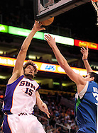 Mar. 16 2010; Phoenix, AZ, USA; Phoenix Suns center Robin Lopez (15) puts up a shot against Minnesota Timberwolves center Darko Milicic (31) in the second half at the US Airways Center.  The Suns defeat the Timberwolves 152-114. Mandatory Credit: Jennifer Stewart-US PRESSWIRE.