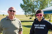 Tour Leader Bob Cochran and Saskatchewan Cycling Association Executive Director Sarah Honeysett, at start of GASP 2015 tour, Mackling Lake Regional Park, Macklin, SK, near the Alberta border.