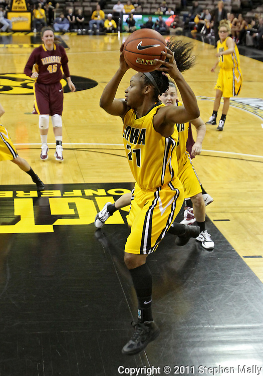February 10 2011: Iowa Hawkeyes guard Kachine Alexander (21) pulls down a rebound during the first half of an NCAA women's college basketball game at Carver-Hawkeye Arena in Iowa City, Iowa on February 10, 2011. Iowa defeated Minnesota 64-62.