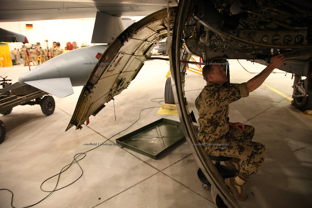 A mechanic inspects a Tornado jet in Camp Marmal, Mazar-e Sharif