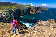 Hiker enjoying the view from Cavern Point, Santa Cruz Island, Channel Islands National Park, California USA