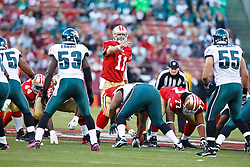 October 10, 2010; San Francisco, CA, USA;  San Francisco 49ers quarterback Alex Smith (11) calls a play against the Philadelphia Eagles during the first quarter at Candlestick Park. The Eagles defeated the 49ers 27-24.