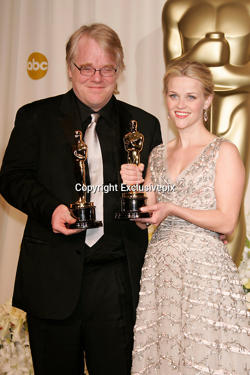 Mar 05, 2006; Hollywood, CA, USA; OSCARS 2006: <br /> <br /> Best Actor' PHILIP SEYMOUR HOFFMAN and 'Best Actress' REESE WITHERSPOON in the press room at the 78th Annual Academy Awards held at the Kodak Theater in Hollywood<br /> &copy;Exclusivepix