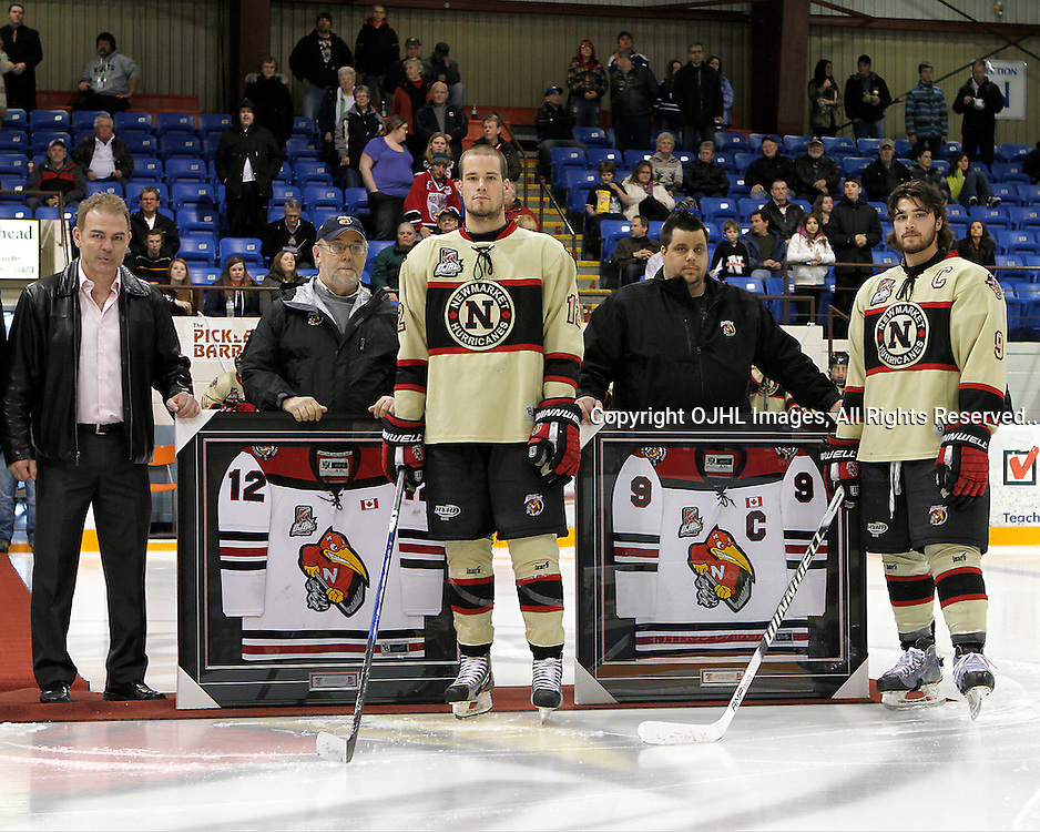 NEWMARKET, ON - Apr 2 : Ontario Junior Hockey League, North-East Conference Championship series between the Kingston Voyageurs and the Newmarket Hurricanes, Elliott Burlon #12 and Chris Chiste #9 of the Newmarket Hurricanes are honoured before the game.(Photo by Brian Watts / OJHL Images)