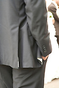 businessman standing with his hand in his pocket