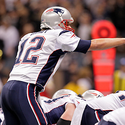 2009 November 30: New England Patriots quarterback Tom Brady (12) under center during a 38-17 win by the New Orleans Saints over the New England Patriots at the Louisiana Superdome in New Orleans, Louisiana.