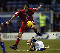 Photo: Jonathan Butler.<br />Leicester City v Cardiff City. Coca Cola Championship. 23/12/2006.<br />Ricky Scimeca of Cardiff jumps the tackle of Iain Hume of Leicester.