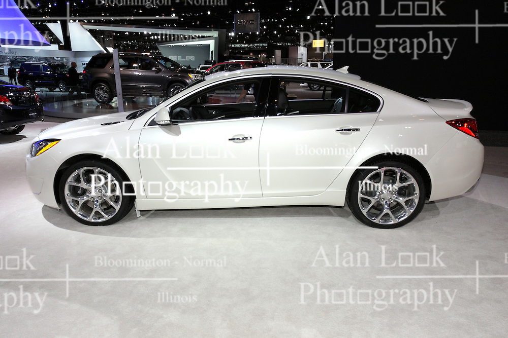 08  February 2013: Buick Regal GS. Chicago Auto Show, Chicago Automobile Trade Association (CATA), McCormick Place, Chicago Illinois<br /> <br /> 2013 BUICK REGAL: A popular brand on display in the Buick exhibit is the Regal lineup for 2013. Perhaps it's Regal's four-door luxury sport sedan convenience with stylish coupe-like proportions, or that Buick IntelliLink is now stock equipment on all Regal models, and heated steering wheel standard with the Turbo package (excluding GS)? Consumers have their choice of four models, starting with the Regal, Regal Turbo, and two new editions - Regal with eAssist (fuel-saving technology), and the high-output Regal GS. There are also five trim levels: Regal (1SL), Premium I (1SN), Premium II (1SP), Premium III (1SR) and GS (1SX). All '13 Regal models rely on the excellent horsepower-per-liter ratio of the four-cylinder Ecotec engine family to deliver efficient, on-demand performance. The 182 horsepower Ecotec 2.4 liter with eAssist is the entry powertrain on Regal 1SL, 1SN and 1SP trim levels. Available at no additional charge is the Ecotec 2.0L turbo that delivers 220hp. When ordering the Regal GS, you'll receive special bodywork and interior trim; a high-output turbo with 270hp, Brembo front brakes and 19-inch alloy wheels or optional 20-inch polished alloy rims. A six-speed automatic transmission with driver shift control is paired with each engine. For those drivers that like stickshifts better, there is a six-speed manual gearbox available on Regal Turbo and GS. New exterior colors for 2013 are Black Diamond Tricoat (premium charge), Champagne Silver metallic and Dark Blue metallic. Buick IntelliLink allows smart phone control via voice activation and steering wheel-mounted controls. It also enables streaming stereo audio from the phone through services such as PANDORA Internet radio and Stitcher SmartRadio.