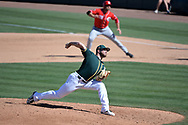 MESA, AZ - MARCH 09:  Bobby Wahl #63 of the Oakland Athletics delivers a pitch in the fourth inning as Joey Votto #19 of the Cincinnati Reds leads off first in the spring training game at HoHoKam Stadium on March 9, 2017 in Mesa, Arizona.  (Photo by Jennifer Stewart/Getty Images)