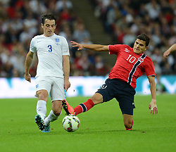 Norway's Tarik Elyounoussi fouls England's Leighton Baines (Everton) - Photo mandatory by-line: Alex James/JMP - Mobile: 07966 386802 - 3/09/14 - SPORT - FOOTBALL - London - Wembley Stadium - England v Norway - International Friendly