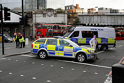 © Licensed to London News Pictures. 14/10/2015. London, UK. Police at the scene where London Bridge in central London is currently closed due to a suspect package. traffic in both directions over the bridge has been stopped. . Photo credit: Mark Baynes/LNP
