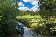 Tourists on barge punting along canal by Coulon in the Marais Poitrevin region a Grand Site de France