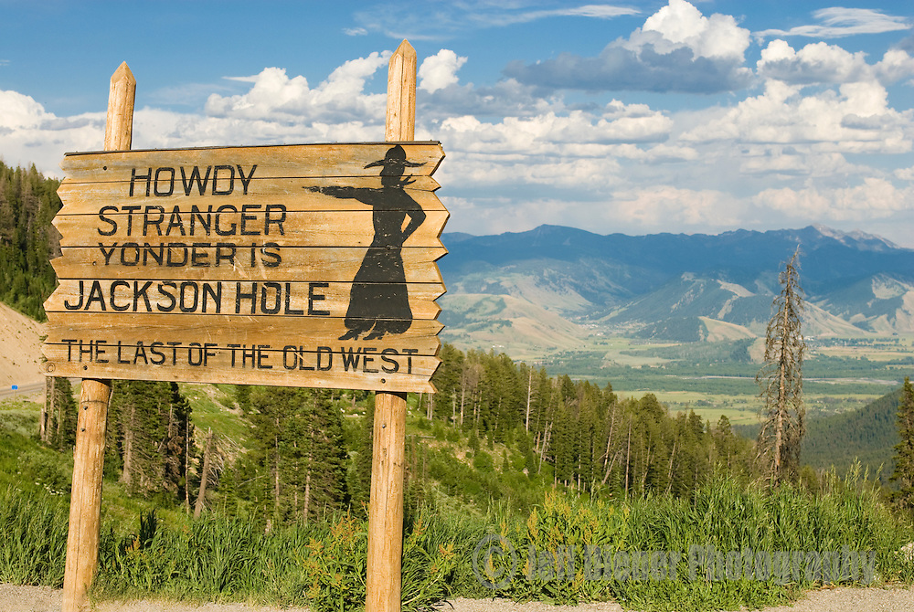 "The ""Howdy Stranger"" sign welcomes visitors atop Teton Pass in Jackson Hole, Wyoming."