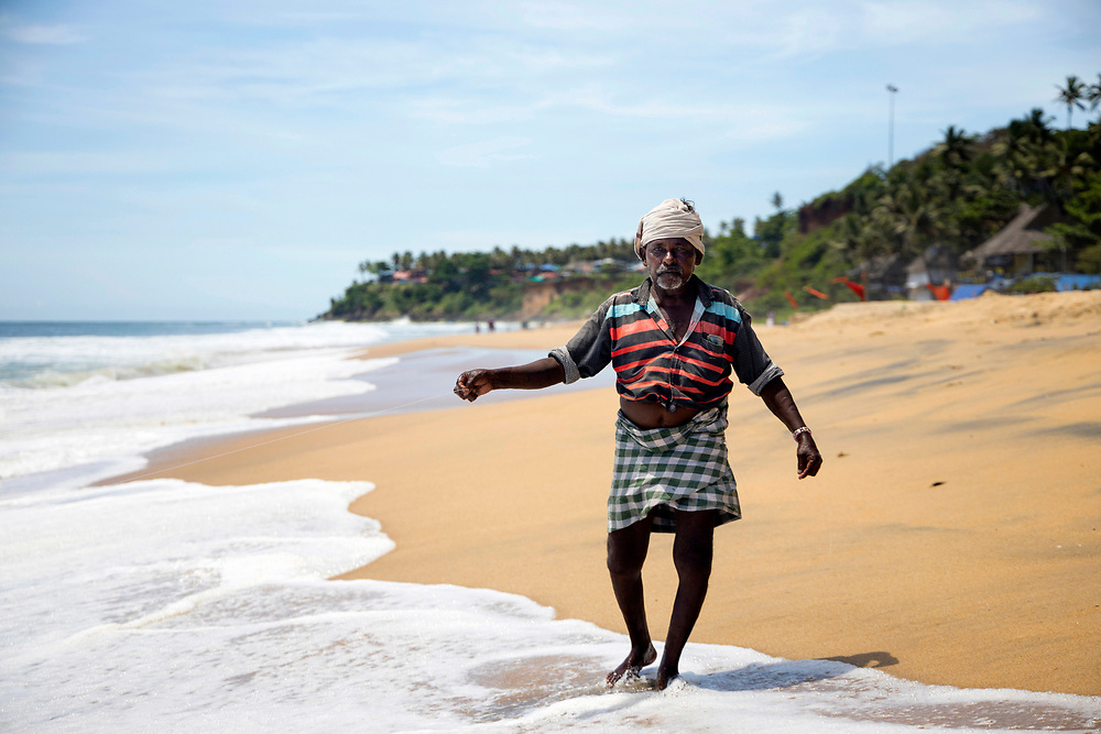 VARKALA, INDIA - 27th September 2019 - Portrait of a fisherman working at Varkala Cliff Beach, Kerala, Southern India