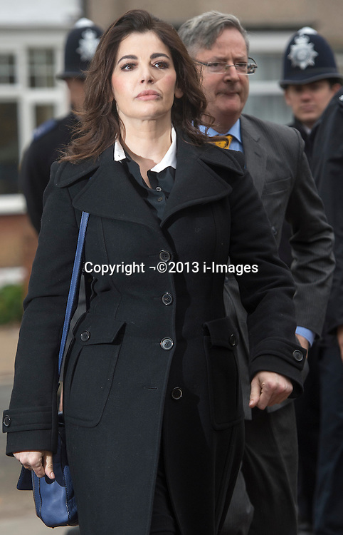 The TV Chef Nigella Lawson arrives at Isleworth Crown Court. London, United Kingdom. Wednesday, 4th December 2013. The TV chef is expected to testify today at trial for Francesca and Elisabetta Grillo, who appear charged with fraud after allegedly using a company credit card to defraud the TV chef and her former husband out of ¬£300,000. Picture by i-Images<br /> File Photo  - Nigella Lawson and Charles Saatchi PAs cleared of fraud. The trial of Francesca Grillo, 35, and sister Elisabetta, 41, heard they spent £685,000 on credit cards owned by the TV cook and ex-husband Charles Saatchi.<br /> Photo filed Monday 23rd December 2013