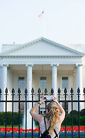 Woman taking pictures of the White House Washington DC USA&#xA;<br />