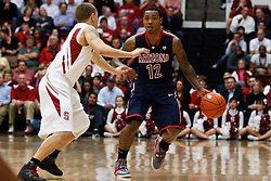 February 3, 2011; Stanford, CA, USA;  Arizona Wildcats guard Lamont Jones (12) is defended by Stanford Cardinal guard Aaron Bright (2) during the second half at Maples Pavilion.  Arizona defeated Stanford 78-69.