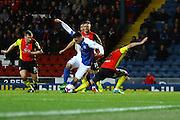 Tony Watt challenged during the Sky Bet Championship match between Blackburn Rovers and Birmingham City at Ewood Park, Blackburn, England on 8 March 2016. Photo by Pete Burns.