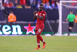 July 25, 2018 - East Rutherford, NJ, U.S. - EAST RUTHERFORD, NJ - JULY 25:  Liverpool forward Sadio Mane (10) salutes the crowd during the second half of the International Champions Cup Soccer game between Liverpool and Manchester City on July 25, 2018 at Met Life Stadium in East Rutherford, NJ.  (Photo by Rich Graessle/Icon Sportswire) (Credit Image: © Rich Graessle/Icon SMI via ZUMA Press)