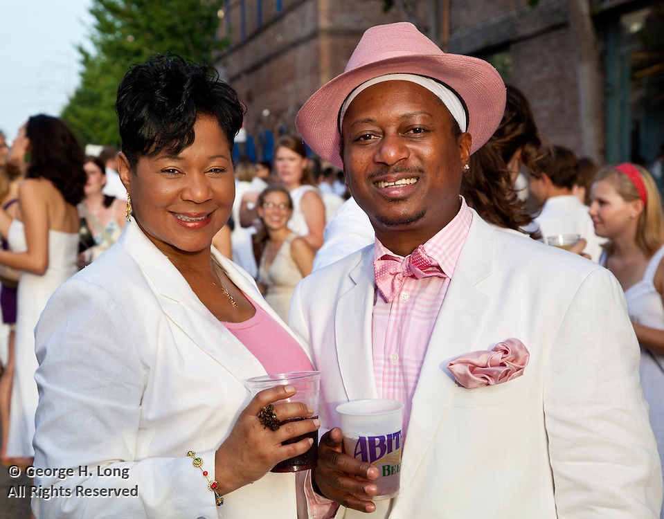 "Karen ""Juicee"" and Kermit Ruffins wearing pink at White Linen Night 2009; Julia Street; Warehouse District of New Orleans"