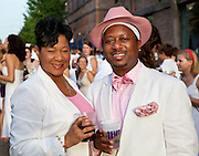 "Karen ""Juicee"" and Kermit Ruffins wearing pink at White Linen Night 2009; Julia Street; Warehouse District of New Orleans"