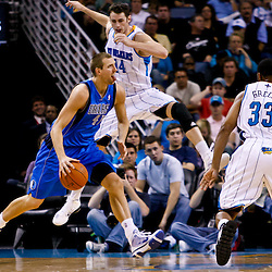 November 17, 2010; New Orleans, LA, USA; Dallas Mavericks power forward Dirk Nowitzki (41) of Germany drives past New Orleans Hornets power forward Jason Smith (14) during a game at the New Orleans Arena. The Hornets defeated the Mavericks 99-97. Mandatory Credit: Derick E. Hingle