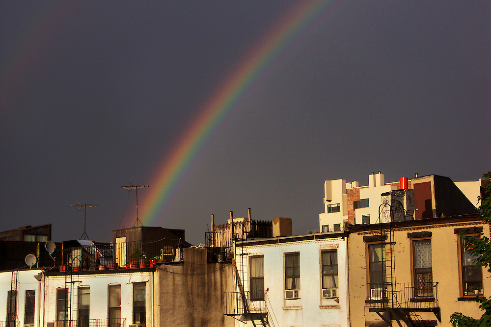 A double rainbow after a passing thunder storm, seen on June 1, 2004. No time to get a more interesting foreground.