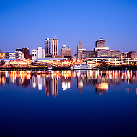Picture of Peoria Illinois skyline at night downtown city buildings reflection on the Illinois River and the Spirit of Peoria paddlewheel riverboat.